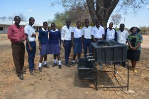 The Water Project:  Students Listen During The Handwashing Training