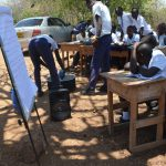 The Water Project: Nyanyaa Secondary School -  Students Look At A Poster During The Training