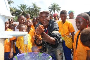 The Water Project:  Headman Playing With Water