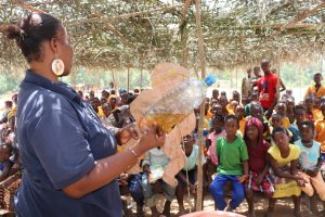 The Water Project:  Hygiene Trainer With The Diarrhea Doll