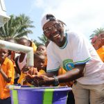 The Water Project: Lokomasama, Gbonkogbonko, Kankalay Primary School -  The Town Chief Rejoicing At The Well