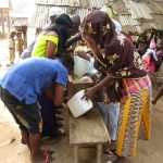 The Water Project: Lungi, Mahera, Mahera Health Clinic -  Participants Constructing Tippy Tap