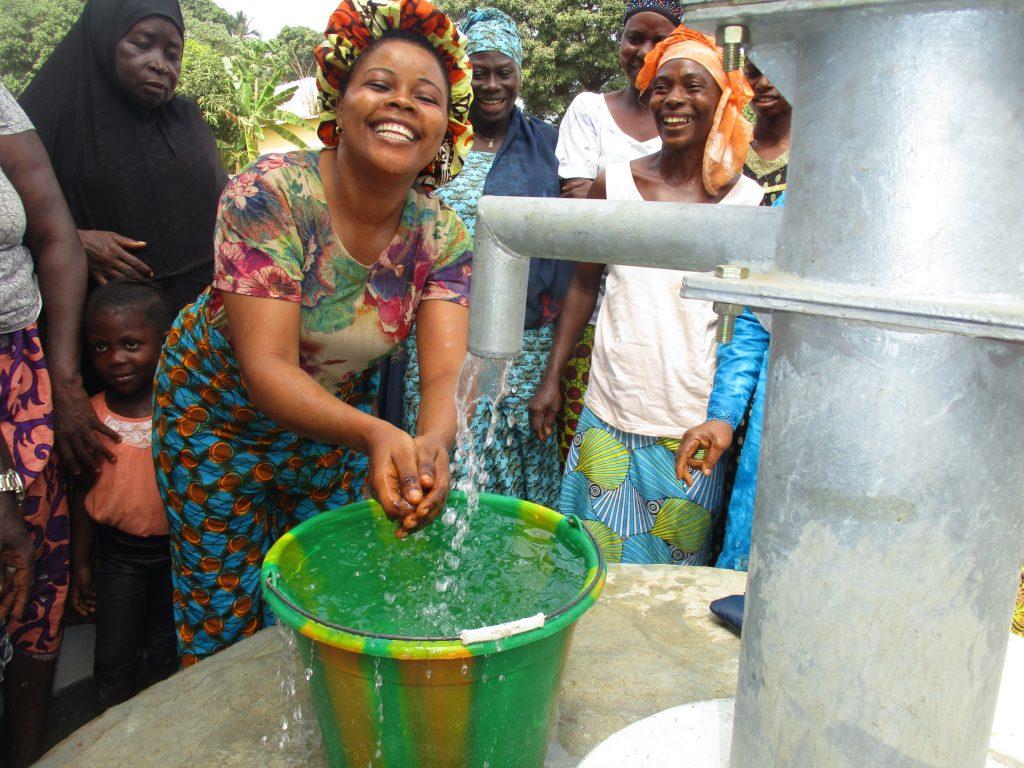 The Water Project : sierraleone20401-woman-joyfully-playing