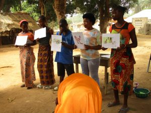 The Water Project:  Community Members Teaching And Displaying Disease Transmission Stories