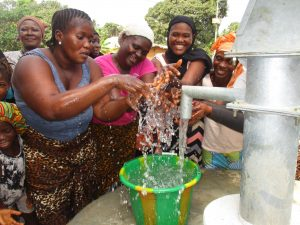 The Water Project:  Happy Women Splashing Water