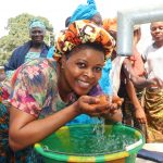The Water Project: Lungi, Mahera, Mahera Health Clinic -  Woman Drinking Clean And Safe Water