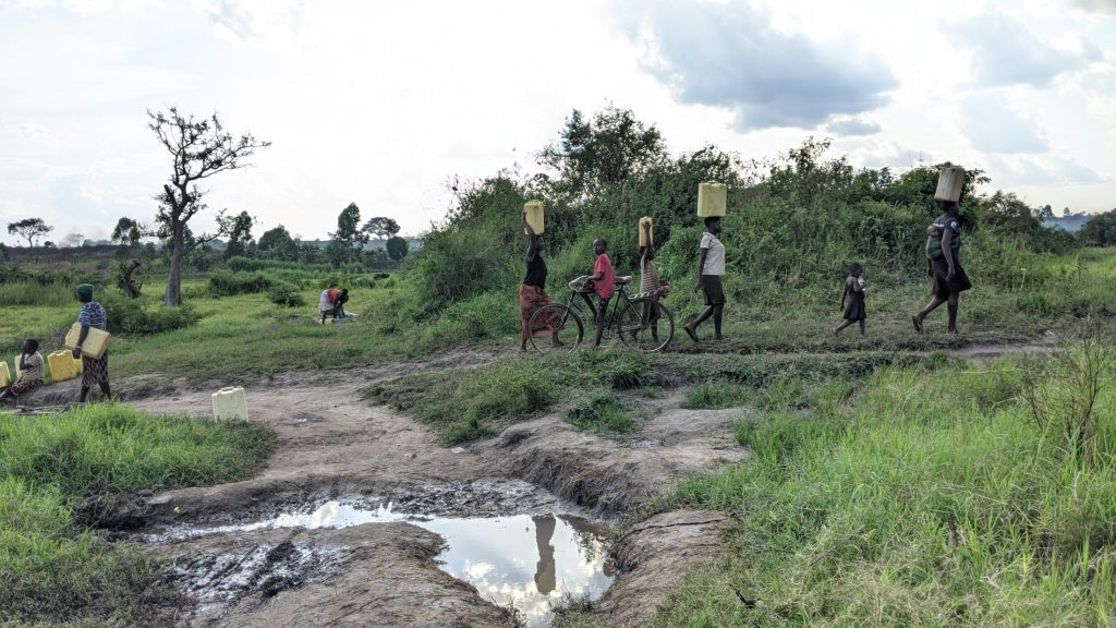 The Water Project : uganda20502-carrying-water-home