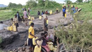 The Water Project:  Fetching Water At The Scoop Hole