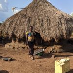 The Water Project: Alero B Community -  Standing In Front Of Kitchen