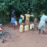 The Water Project: Kinuma Kyarugude Community -  Containers Lined Up To Fetch Water
