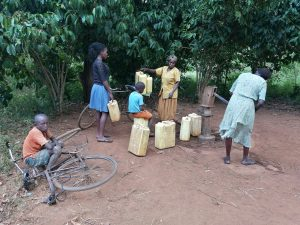 The Water Project:  Containers Lined Up To Fetch Water