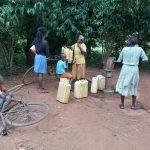 The Water Project: Kinuma Kyarugude Community -  Pumping Water