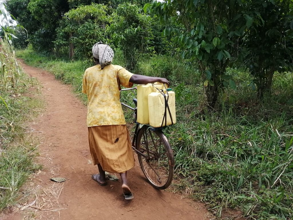 The Water Project : uganda20504-pushing-bicycle-with-water
