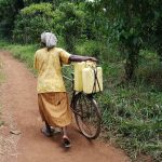 The Water Project: Kinuma Kyarugude Community -  Pushing Bicycle With Water