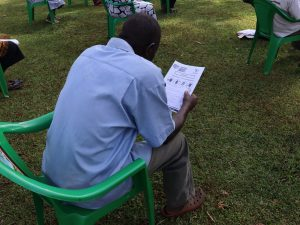 The Water Project:  A Community Member Reading Through The Manual