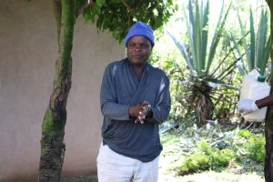 The Water Project:  A Elderly Gent Showcasing His Handwashing Expertise