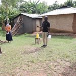 The Water Project: Ematetie Community, Weku Spring -  A Community Health Volunteer Addressing The Group