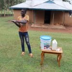 The Water Project: Elukuto Community, Isa Spring -  A Community Member Illustrates Handwashing At The Training