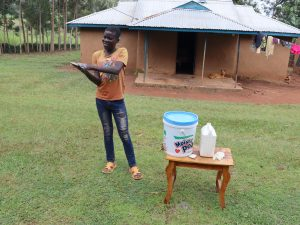 The Water Project:  A Community Member Illustrates Handwashing At The Training