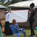 The Water Project: Elutali Community, Obati Spring -  Facilitators Review Prevention Reminders Chart