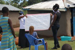 The Water Project:  Facilitators Review Prevention Reminders Chart