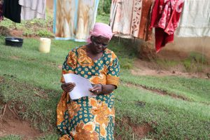 The Water Project:  An Elderly Woman Reading Through The Pamphlet
