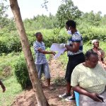 The Water Project: Shitoto Community, Abraham Spring -  Passing Out Informational Pamphlets