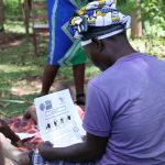 The Water Project: Shirugu Community, Shapaya Mavonga Spring -  Reading Informational Pamphlet