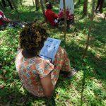 The Water Project: Shiamala Community, David Ashiona Spring -  Reading Coronavirus Informational Pamphlet