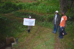 The Water Project:  Sir Erick With The Chart At The Spring With Community Members