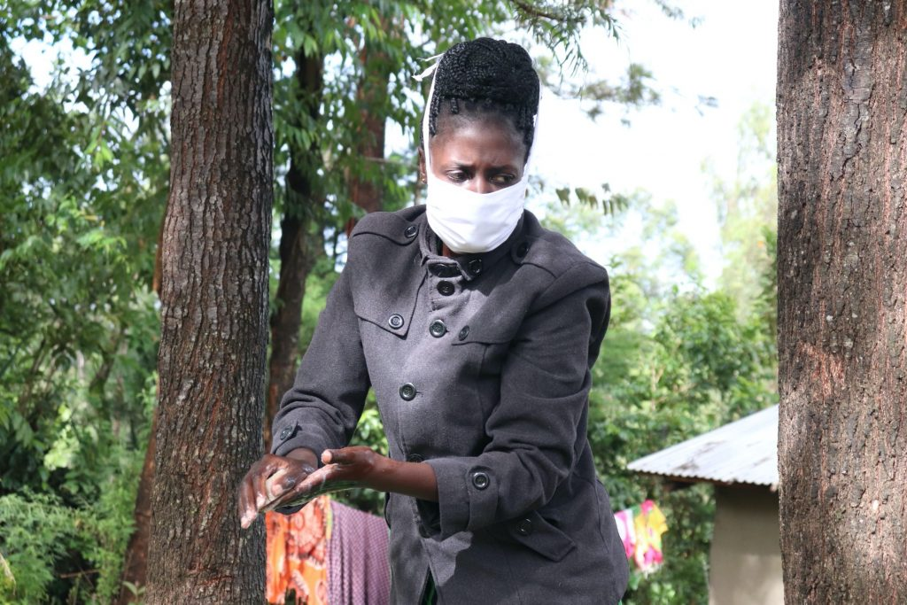 The Water Project : 10-covid19-kenya4736-the-faciliator-during-handwashing-demonstration