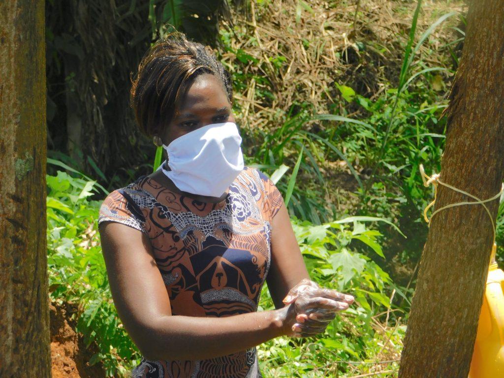 The Water Project : 10-covid19-kenya18314-lynah-demonstrates-handwashing