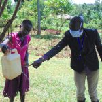 The Water Project: Visiru Community, Kitinga Spring -  Handwashing With Leaky Tin Demonstration