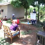 The Water Project: Chegulo Community, Yeni Spring -  Using The Prevention Reminder Chart