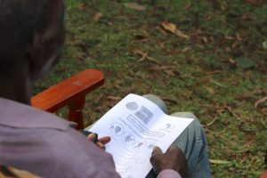The Water Project:  A Community Member Reads Informational Pamphlet