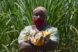 The Water Project:  Portrait Of A Community Member With Her Mask