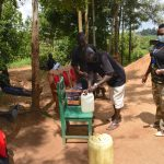 The Water Project: Musango Community, M'muse Spring -  Handwashing Demonstration