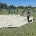 The Water Project: St. Michael Mukongolo Primary School -  Knitting Sacks Onto Wire For Dome Construction