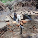 The Water Project: Shikangania Community, Abungana Spring -  Setting The Discharge Pipe
