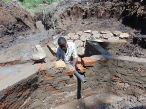 The Water Project:  Setting The Discharge Pipe