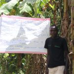 The Water Project: Asimuli Community, John Omusembi Spring -  A Gent Next To The Chart Installed At The Spring