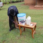 The Water Project: Elukuto Community, Isa Spring -  Using Local Materials To Make Handwashing Stations