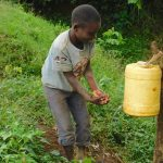 The Water Project: Mungakha Community, Nyanje Spring -  A Young Boy Demonstrates Handwashing