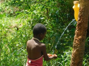 The Water Project:  Angel Shows How Handwashing Is Done