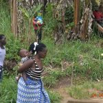 The Water Project: Emukoyani Community, Ombalasi Spring -  Mothers Carry Their Babies While Listening To Training