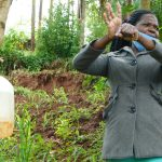The Water Project: Busichula Community, Marko Spring -  Trainer Lynnah Demonstrates The Ten Handwashing Steps