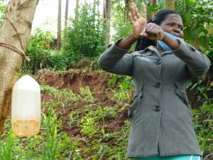 The Water Project:  Trainer Lynnah Demonstrates The Ten Handwashing Steps