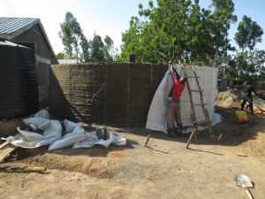 The Water Project:  Removing Sacks Reveals Interior Cement
