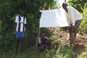 The Water Project:  Posing Next To The Chart
