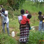 The Water Project: Emukoyani Community, Ombalasi Spring -  Trainer Protus Installs The Handwashing Station At The Spring